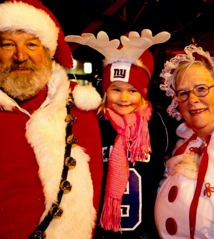 Jayna Burris, 4, visits with Santa and Mrs. Claus. She is from Brockport and was at the parade with mother, Jessica.
