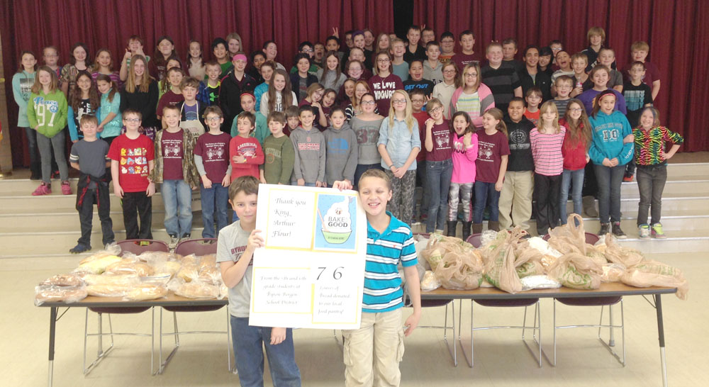 Young bakers from grades five and six at Byron-Bergen Elementary School shared 83 loaves of their wonderful home-baked bread (the loaves just kept multiplying after this photo was taken) with Genesee Orleans Community Action food pantry. The flour and recipes were donated to the school by King Arthur Flour's Bake for Good Program.