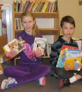 Cora Bennage and Cavan Bennage collected books from classmates at Holley Elementary and donated them to Oak Orchard facilities.