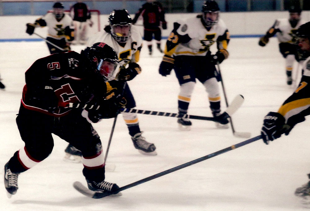 Coon (#5) is part of the attack on goal in a recent game against Irondequoit. Photograph by Walter Horylev.