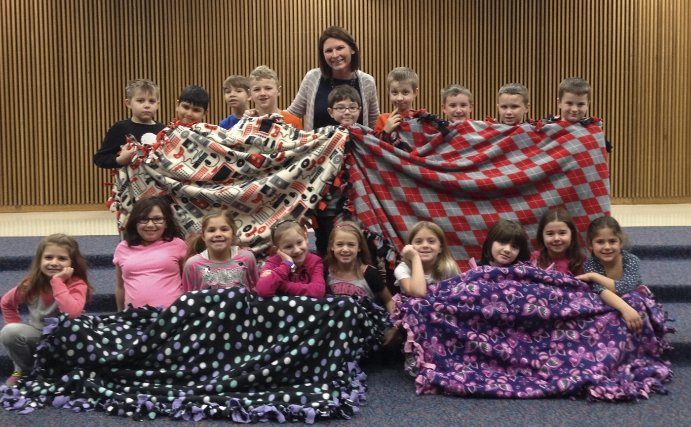 Lauren Steinbach's second grade class at Northwood Elementary School with the blankets they made for Golisano Children's Hospital: (front, l-r) Isabella DeGiacco, Nevaeh Fedele, Sydney Fisher, Theresa Vogt, Ava Mason, Savannah Bisig, Paige Eckert, Marisa Thomas and Francesca Huyghe; (back) Lucas Maier-Rennoldson, Joey Piperni, Nikolas Russo, Tanner Smith, Max Norton, Teacher Lauren Steinbach, Aidan Bowdish, Gabe Ammer, Ronnie LeBeau and Payden Prince. Not shown, Ashlee Ahern, Zachary Irwin and Shayna Weeks.