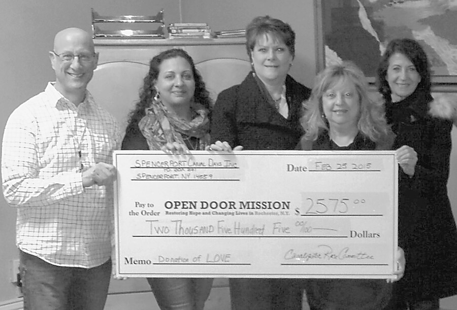 Funds presented to Open Door Mission - Shown (l to r) Christopher Scribani, Karin Pena, Lori Antonelli, Alba Alonci and Becky Daniels. Provided photo.