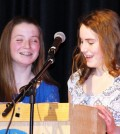 Eighth graders Brooke Schmitt (left) and Mackenzie Johnson talk about the characteristics of membership in the National Junior Honor Society during an induction ceremony at Merton Williams Middle School in Hilton. Provided photo