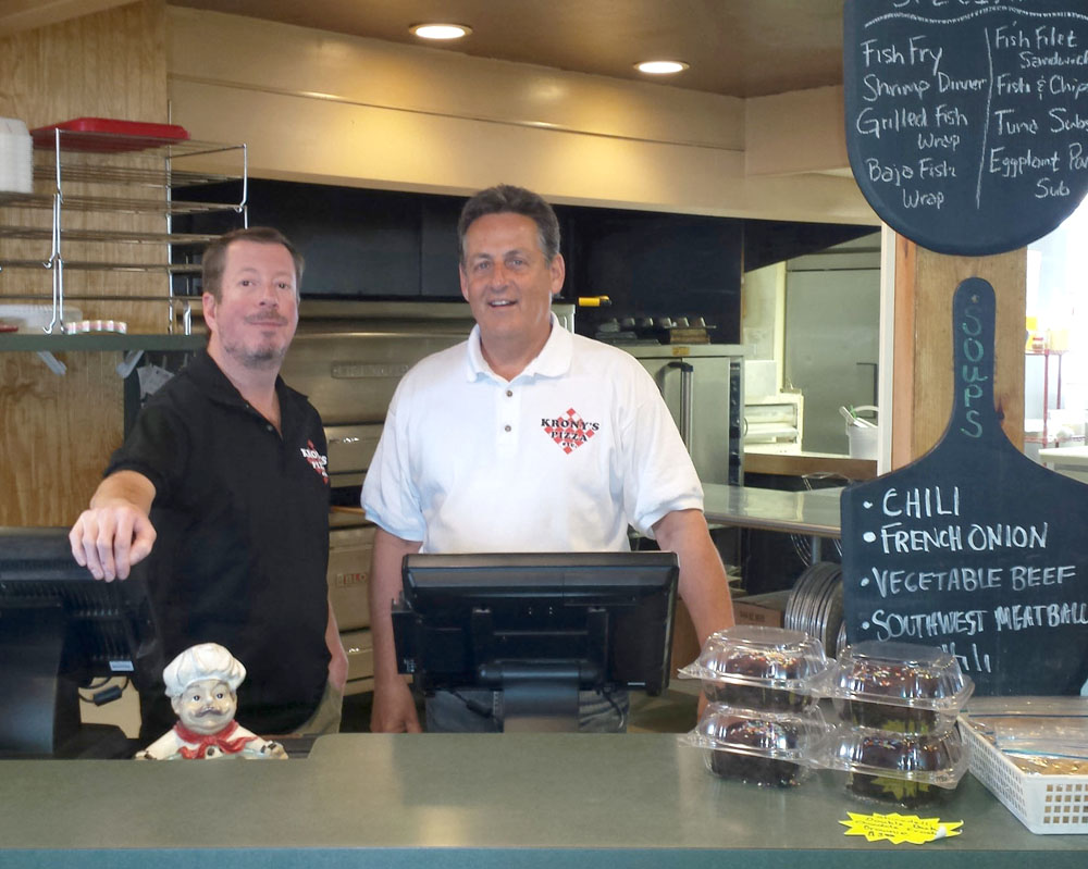 Both Krony's locations - at 500 Hamlin-Clarkson Townline Road in Hamlin and 2139 North Union Street (Barefoot Landing Plaza) in Spencerport - are celebrating 20 years since the opening of the Spencerport location with a roll-back of prices to those of twenty years ago. Above, Mark Kronenberg (right) joins Spencerport owner Steve Enos at the Spencerport Krony's. WN staff photo.