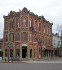 "The ""Decker's Block"" building was constructed as a bank in 1871 and is one of the most striking in the Brockport business district. It was suffering from neglect when Darlene moved in. ""It was a sleeping beauty,"" Darlene Trento says and it helped bring her business to life. K. Gabalski photo."