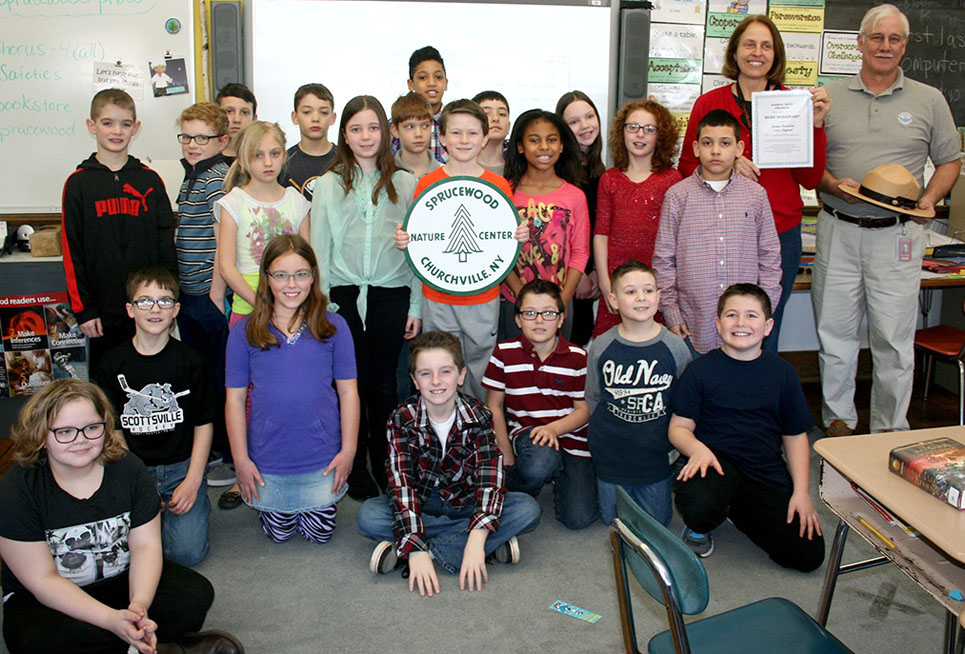 Sprucewood Nature Center guardians, Churchville Elementary School teachers James Reeverts (far right) and Lori Osgood (right) celebrate their RCSS minigrant with Reevert's fourth-grade class of nature fans.