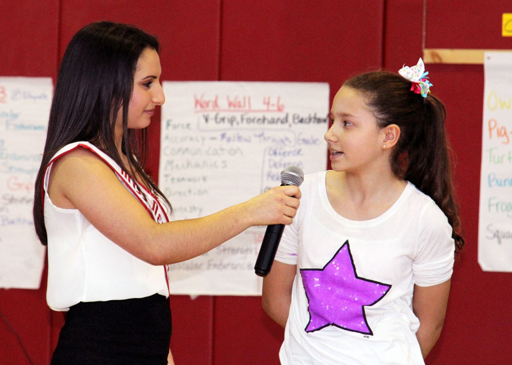 Diana Marie Russo, Miss New York Teen and Hilton High School graduate, talks to Savannah Hicks, a fifth grader at Village Elementary School, about her dreams and goals.