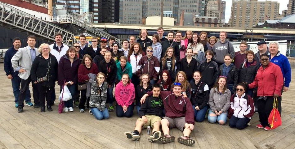 Members of the Byron-Bergen High School Band and Color Guard get together for a picture on the deck of the USS Intrepid after performing an impromptu recital of patriotic music on the ship - just one stop on their whirlwind tour of NYC.