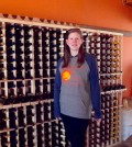 Shane Gustafson in front of the first wine rack to be filled at the new wine outlet on Ridge Road in Parma. Photo by Joe Reinschmidt