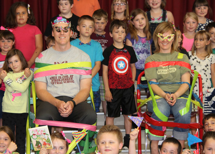 """Stuck on reading - Byron-Bergen Elementary School's Celebration of Reading Challenge proves that Principal Brian Meister and Assistant Principal Amanda Cook, along with the entire student population, are """"stuck"""" on reading."""