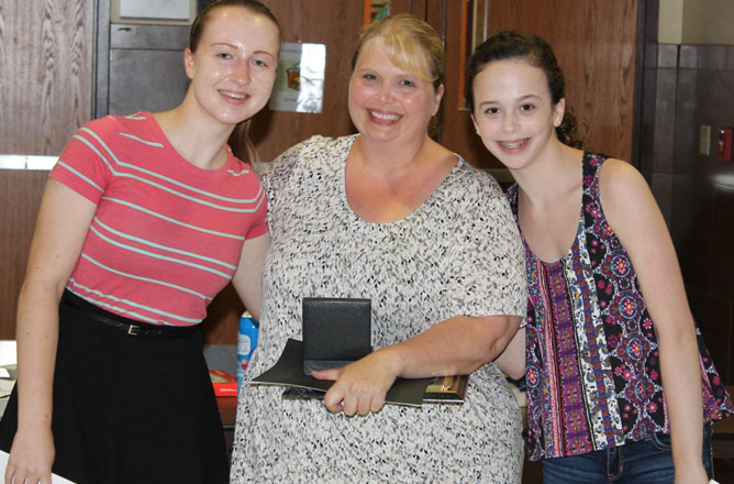 Health education teacher Roxanne Wood, 2015 winner of the Byron-Bergen Golden Bee Award for exemplary standards in teaching, with Student Council members (l) Clare Fraser and (r) Grace Pulcini.