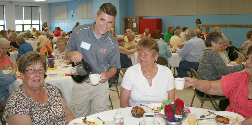 High school student Zach Trask serves coffee at Holley's Senior Citizen Breakfast. Provided photo