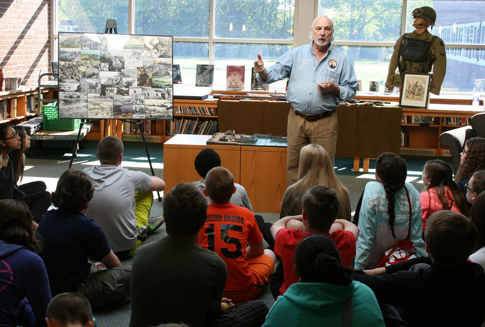 Chuck Baylis, a Vietnam veteran and the executive director of the Military History Society of Rochester, spoke to eighth graders at Merton Williams Middle School about D-Day and showed them artifacts. The Military History Society has a museum, with many Rochester connections, located at 250 North Goodman Street. Provided photo