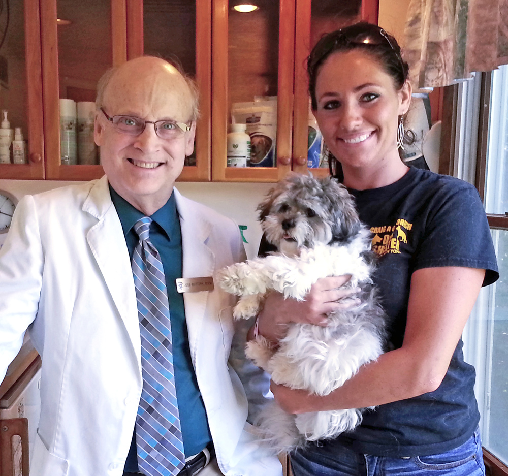 Ready for a good home - Dr. William J. Buttery has just given this puppy her first check up and rabies shot so she will be ready to be adopted. Caroline Thompson, Dave Maynard's assistant at Hamlin's Craig A. GoodrichDog Shelter, is holding her. Photo by Dianne Hickerson