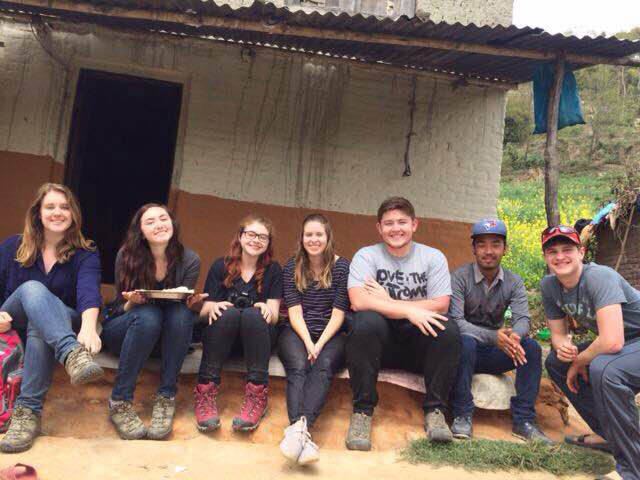 Hannah VanDuzee (third from left) with other members of her YWAM group in Kathmandu in front of a house where the group did fellowship with Nepali Christians. Provided photo