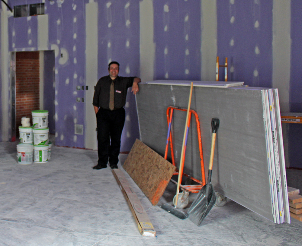 Seymour Library Director Carl Gouveia stands in what will soon be the Local History Room. Most recent work included installation of the sprinkler system and HVAC equipment, along with putting primer on the wall. The room is due to be completed in mid-September. G. Griffee photo
