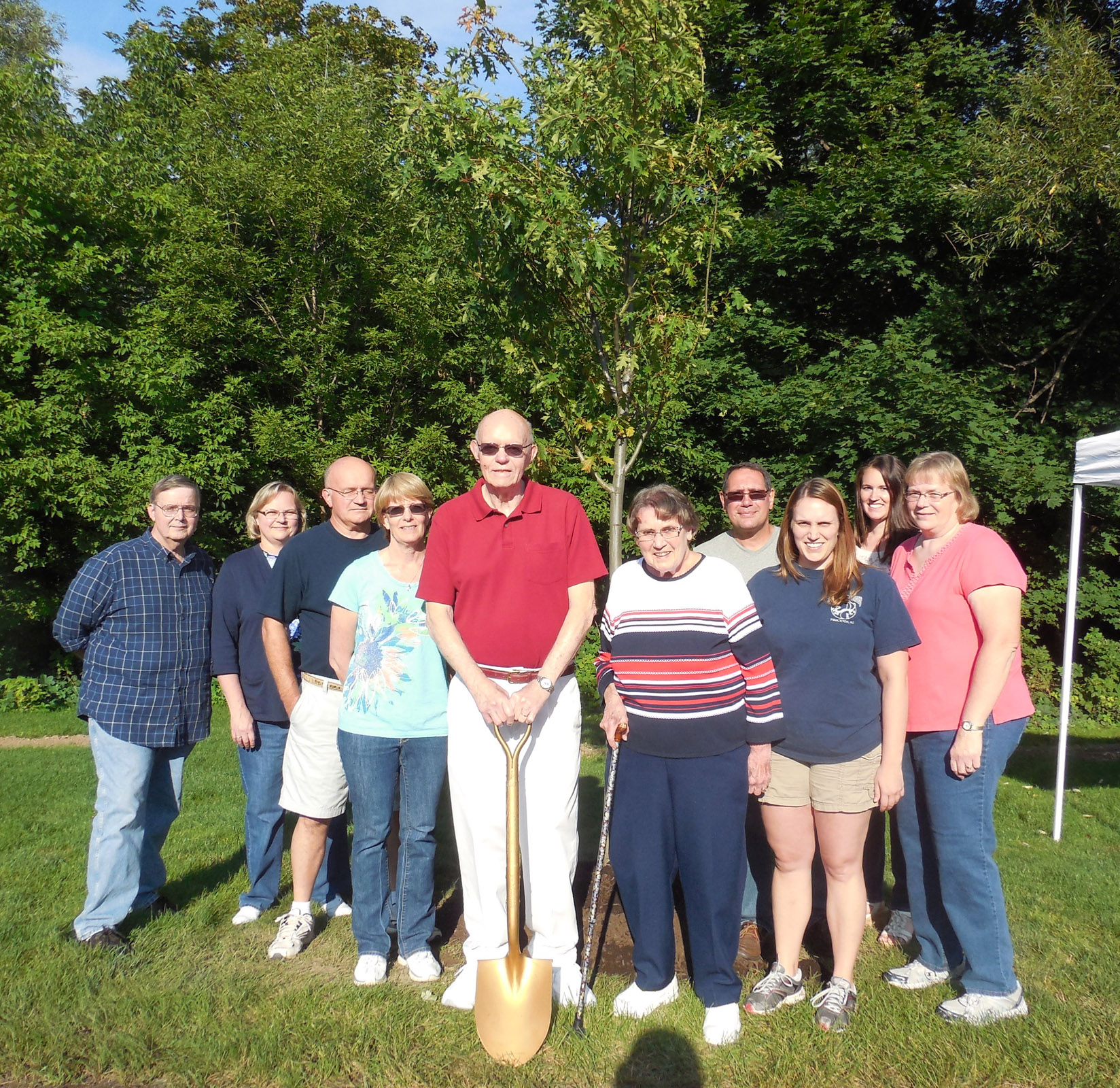 Don Suter standing with family, friends and colleagues just after the tree was planted. Provided photo