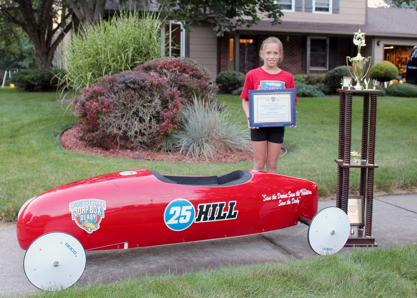 Karlye Murphy, a fifth grader at Village Elementary School in Hilton, received a $3,000 scholarship, World Championship ring, Gold World Championship jacket and a giant trophy for placing first at the World Championship Soap Box Derby Super Stock Race in Akron, OH. The car shown is not the car she raced. That is now on display in the museum at Derby Downs. G. Griffee photo