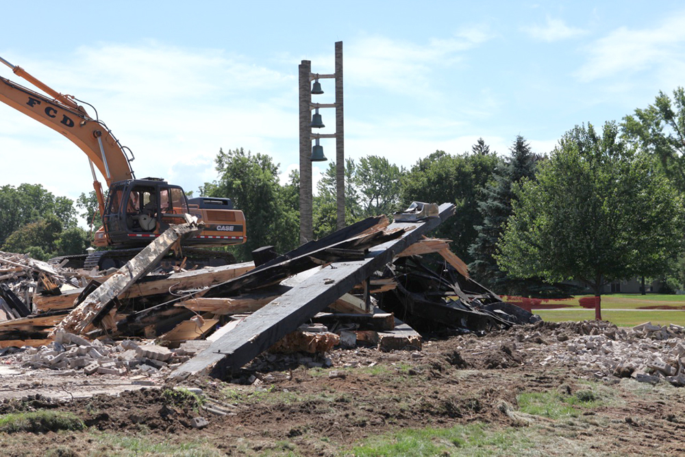 After the January 1 fire that heavily damaged St. Pius X Catholic Church in Chili, parishioners began a campaign to rebuild. Removal of the debris was underway in early August. Provided photo