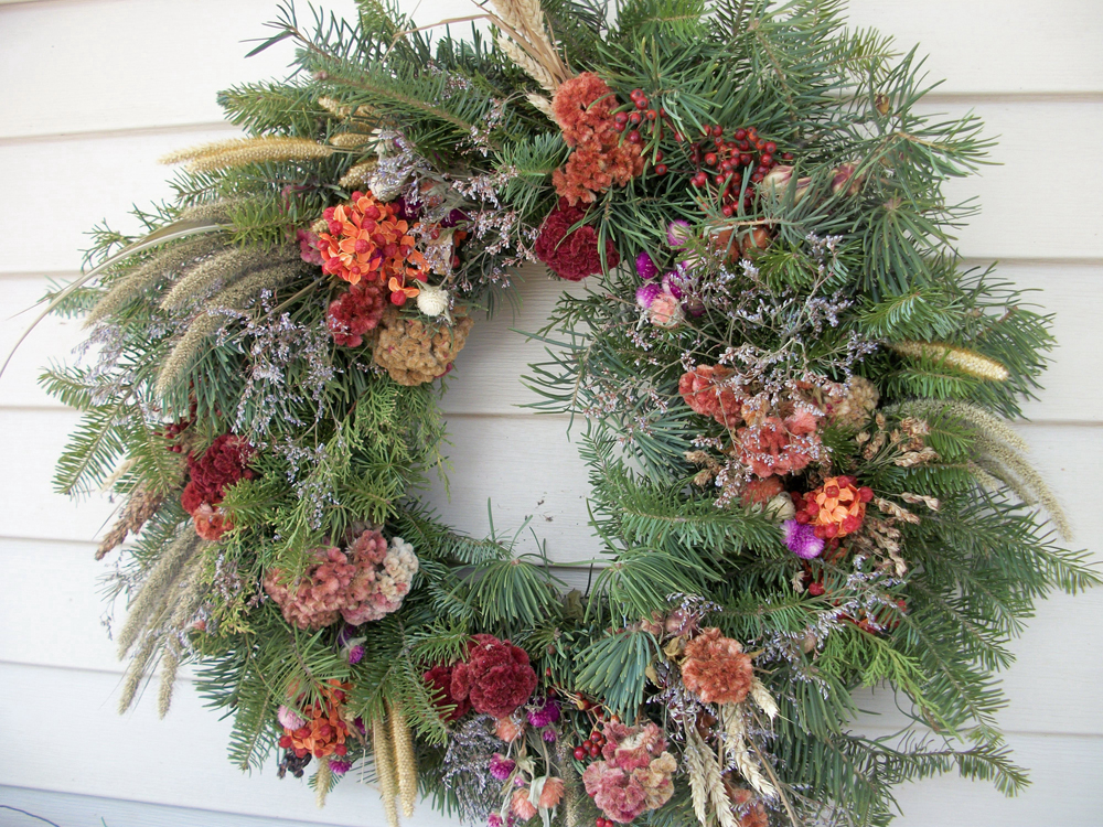This wreath was made for Christmas 2014 and uses dried embellishments including celosia, wheat, foxtail grass, American bittersweet, rose hips, sea lavender and gomphrena. Total cost:  $ -- the cost of the class that includes the evergreen material. Embellishments came from the garden and yard for free. Photo by K. Gabalski