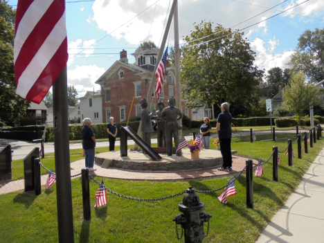 Taking turns at the monument representing the Brockport Volunteer Firefighter's Association Inc. Auxiliary, Mabel Koss, Mary Way, Sandi Ford and Kathy Kandris honor the 343 firefighters and the thousands that perished that day. Provided photo