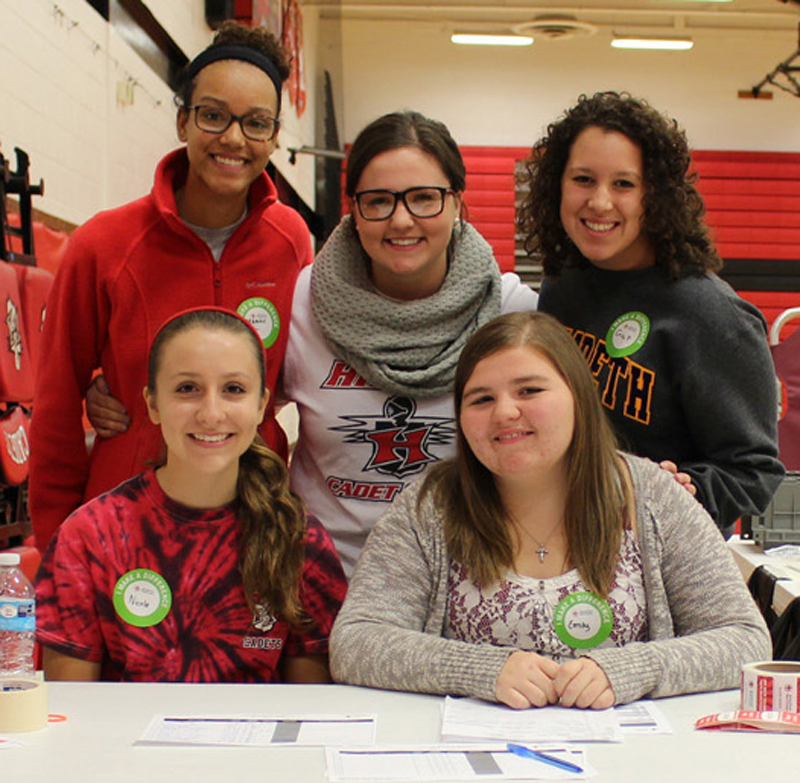 (Front, l-r) Nicole Bradbury and Emily Harris; (back) Madison Walker, Kate West and Erica Peter, all members of the Hilton High School Chapter of the National Honor Society, volunteer at an American Red Cross Blood Drive during Make a Difference Day. Provided photo