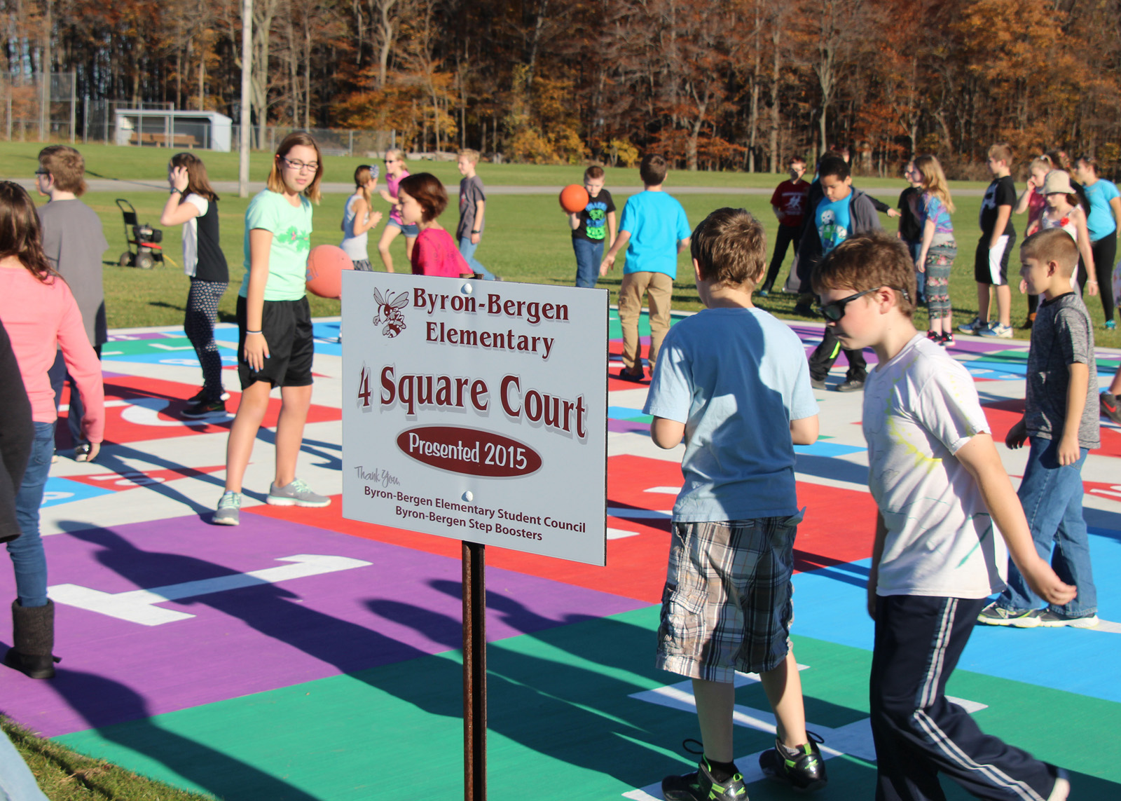 Student Council President Elli Schelemanow thanks everyone who worked so hard to make the new four square court a reality. Provided photo