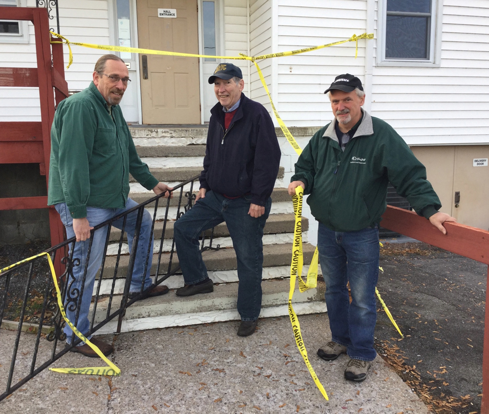 Stair railings were removed by Home Depot and community volunteers before the work detail held on October 29. Shown above: David Shoemaker, Home Depot Team Leader is joined by Gil Budd, Commander, Harvey C. Noone and Mike Brown, Home Depot. Not pictured Bill Whittman. Provided photo