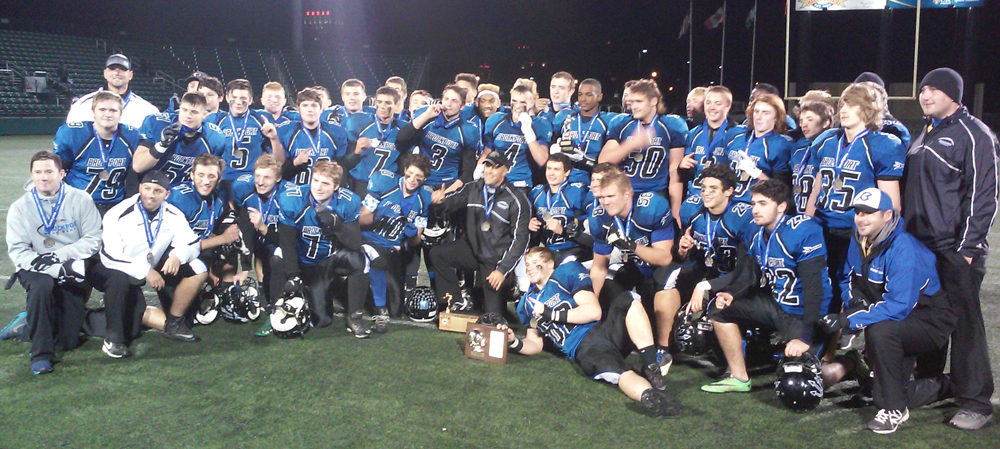 The Brockport Blue Devils gather for a team photo after winning their first ever Section V football title. W. Kozireski photo