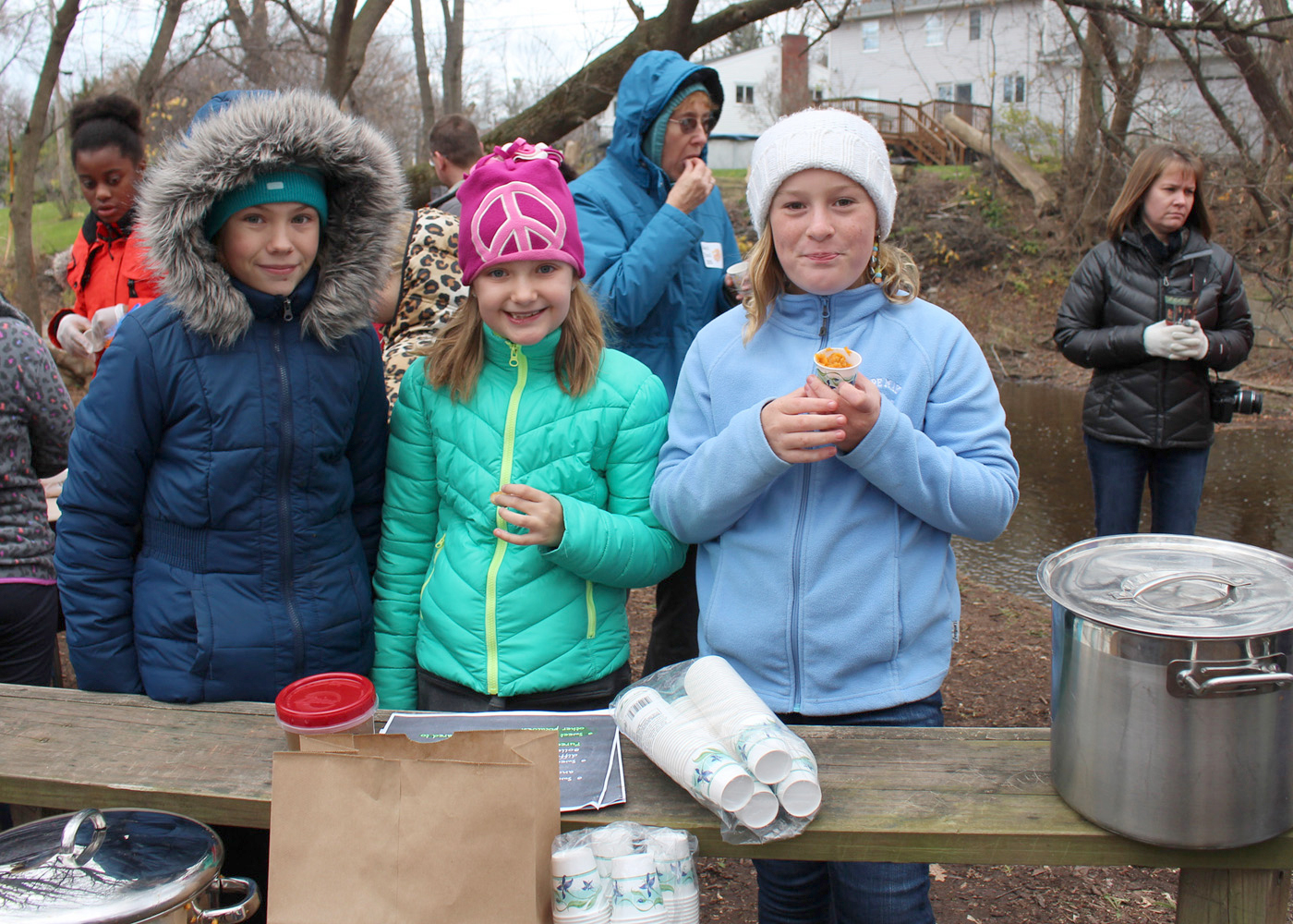 Quest Elementary School students (l-r) Ashley Simons, Autumn Sample and Isabelle Anderson talk to fellow students and visitors about the importance of sweet potatoes to both the Pilgrims and Indians. They also provided homemade samples. Provided photo
