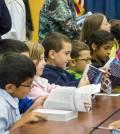Third graders from Longridge Elementary School in Greece examine their new dictionaries.