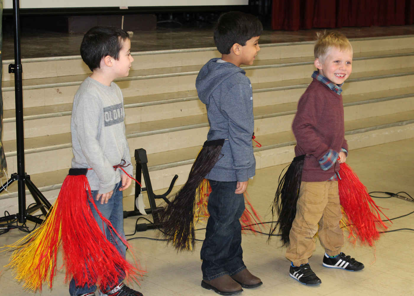 Byron-Bergen Elementary School students shake their tail feathers as part of a traditional Ugandan dance. Provided photo