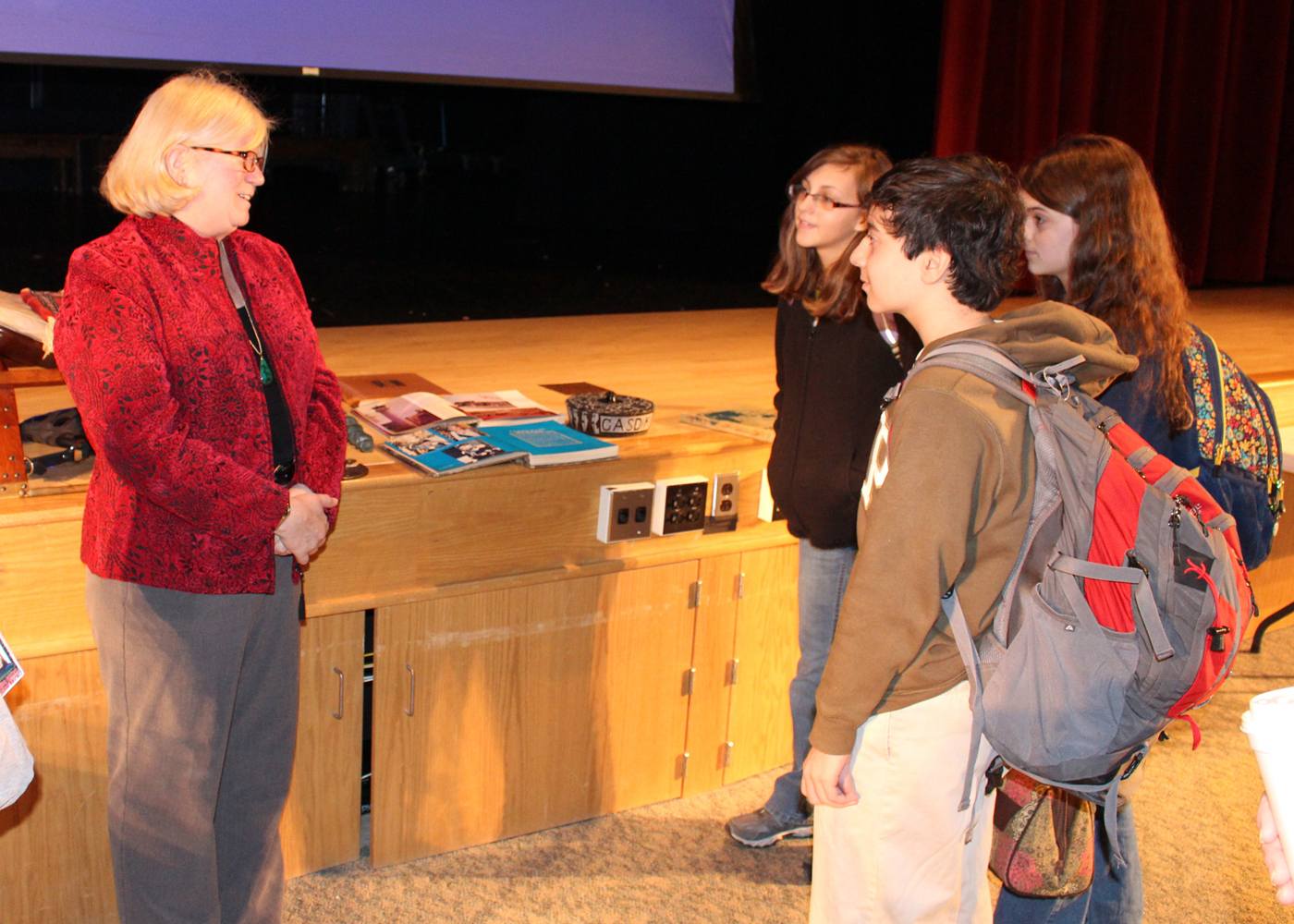 Madeleine Gasdik, who spent part of her childhood in Tehran, Iran as the daughter of a CIA agent, shares with Hilton High School freshmen some of the items she brought back with her.