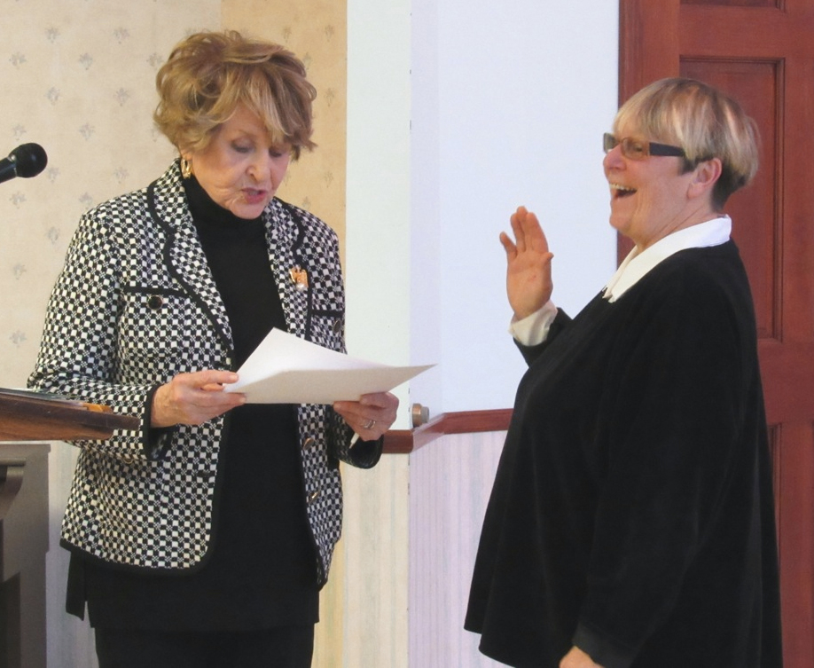 Congresswoman Louise Slaughter performs the swearing-in ceremony for new Sweden Town Board member Lori Skoog.