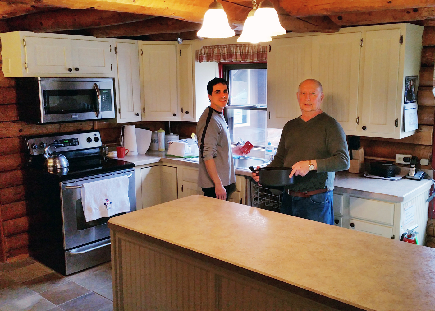 Volunteers (l to r) Dan Melia and Jerry Morissette work in the kitchen at Mt. Carmel House. Photo by Grace Griffee