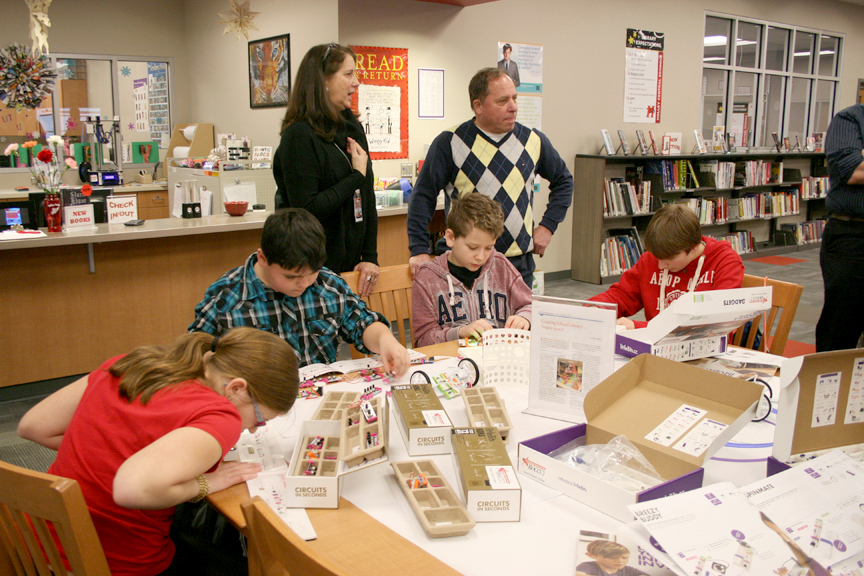 From left, Holley MS/HS Librarian Lisa Osur and Assemblyman Steve Hawley watch students work with littleBits. Provided photo