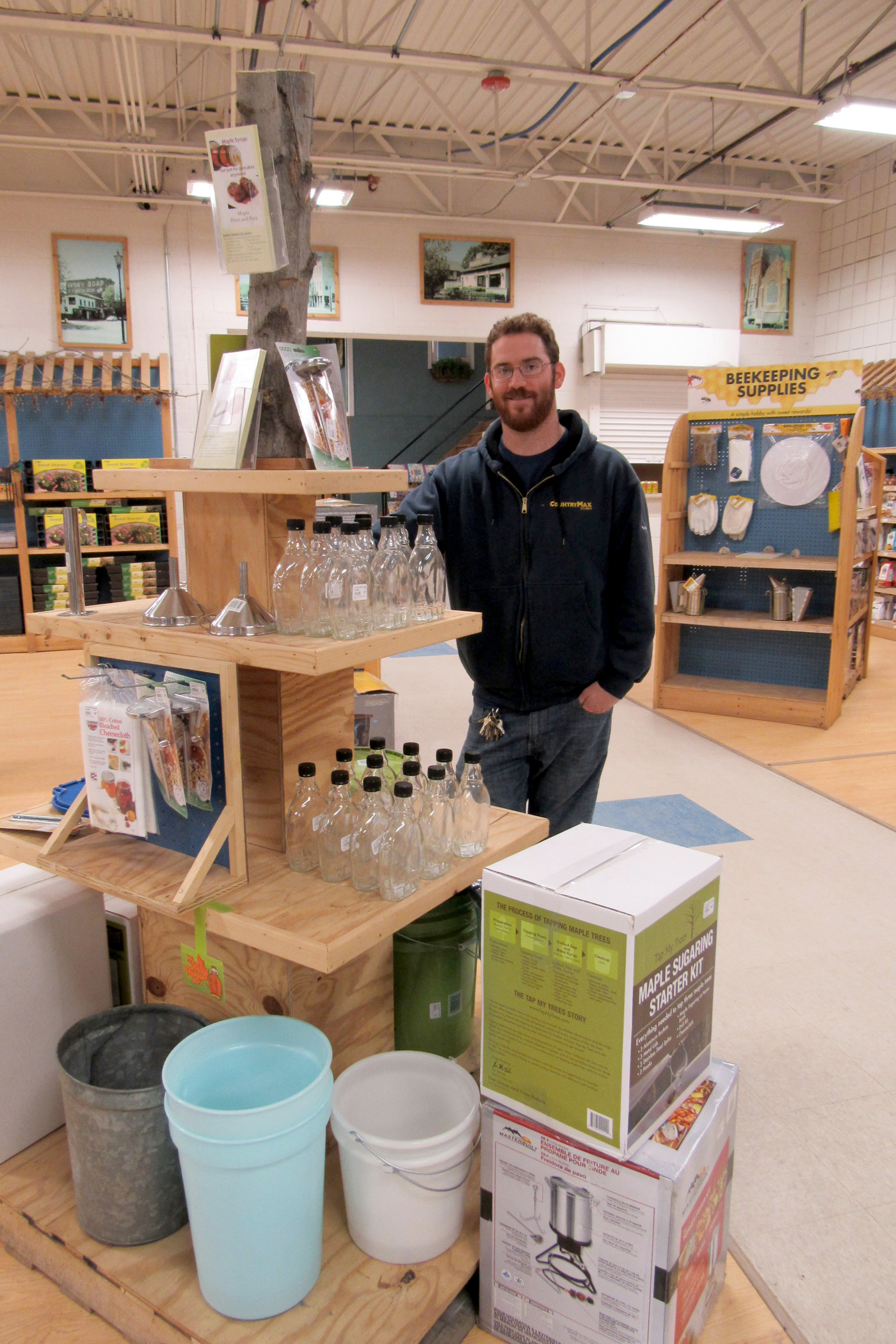 f6f39f3d47f Brockport Country Max store manager Josh Forbes stands next to equipment  and books available for those
