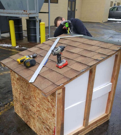 Monroe 2-Orleans BOCES student works on constructing a warm and stable dog house to help shelter the four-legged community. Provided photo