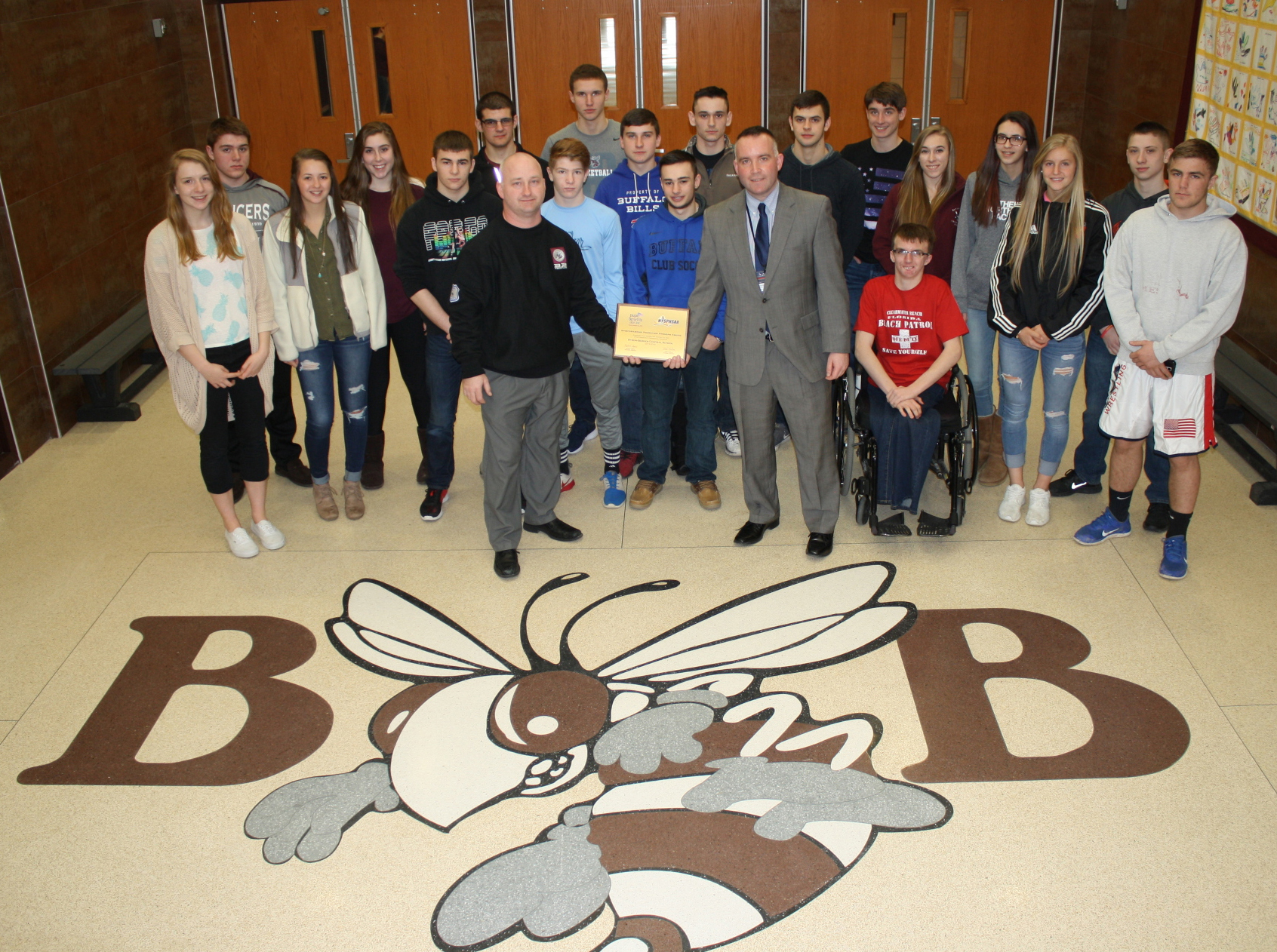Representatives from the Byron-Bergen student athletic teams, along with Athletic Director Rich Hannan (l) and Junior/Senior High School Interim Principal Patrick McGee (r) proudly accept the NYSPHSAA Sportsmanship Promotion Program Award, which honors all players, coaches and spectators alike. Provided photo