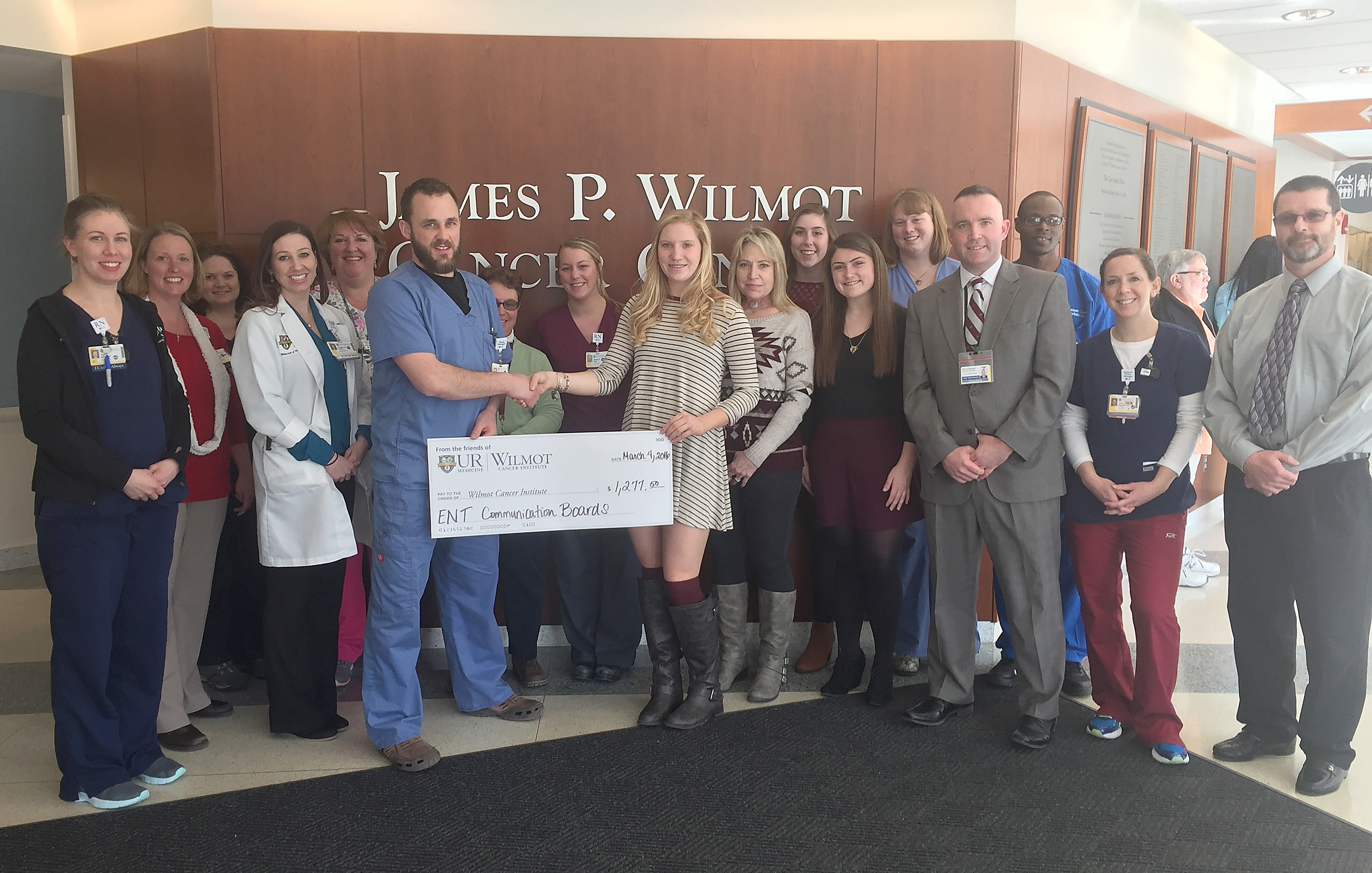 Representatives from the Byron-Bergen girls soccer team presented a check for $1,277 to the doctors and medical team at Strong Hospital's Wilmot Cancer Center. Holding check - High school junior Karson Richenberg. (L-r) Toni Richenberg, junior Olivia Audsley, senior Alex Rosse, Principal Patrick McGee and Coach Wayne Hill. Provided photo