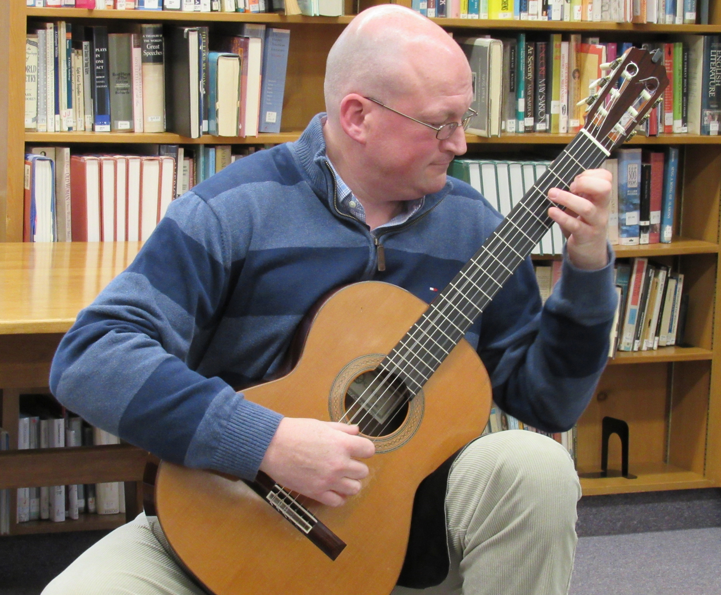 Dr. Kenneth Meyer, a classical guitarist, performed at the Newman Riga Library during National Library Week. K. Gabalski photo