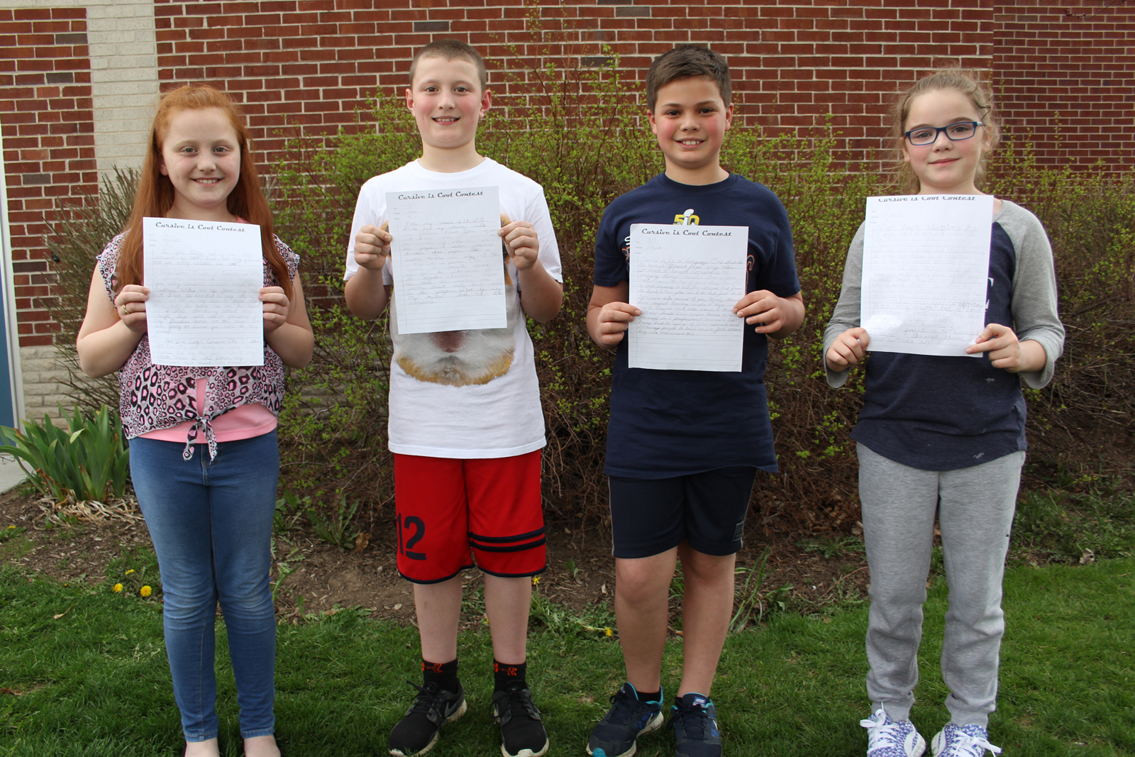 Allyson Fien, Ethan Enderle, Jason Kleehammer and Elsye Klump show off their winning entries. Provided photo