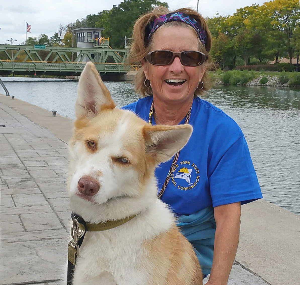 Jane Newcomb rests with Anna at Brockport's Welcome Center near the close of the Erie Canal season last year. For 15 years she was a lift bridge operator for the Park Avenue and (in the background) Main Street bridges.  This season she transfers to the lift bridge at Holley. Dianne Hickerson photo