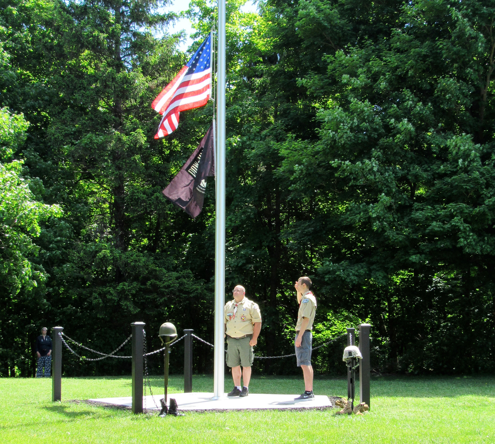 John and Jacob Crandall salute after raising the U.S. Flag and POW/MIA Flag at the new Memorial in Hillside Cemetery on Memorial Day. K. Gabalski photo