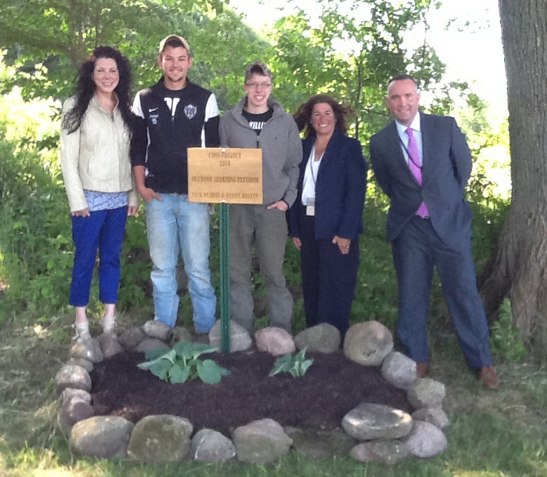 (L-r) Mrs. Feeney, seniors Nick Dubois and Aaron Holley, Dr. Moscicki and Mr. McGee at a new marker and flower bed leading into the Tamra Troke Memorial Trail. Provided photo