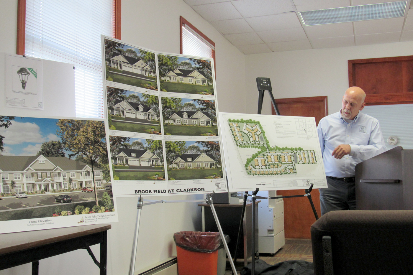 Michael Montalto of Costich Engineering reviews site plans and elevations for the proposed Brook Field at Clarkson housing development during a public hearing held Tuesday, June 7 by the Clarkson Planning Board. K. Gabalski photo
