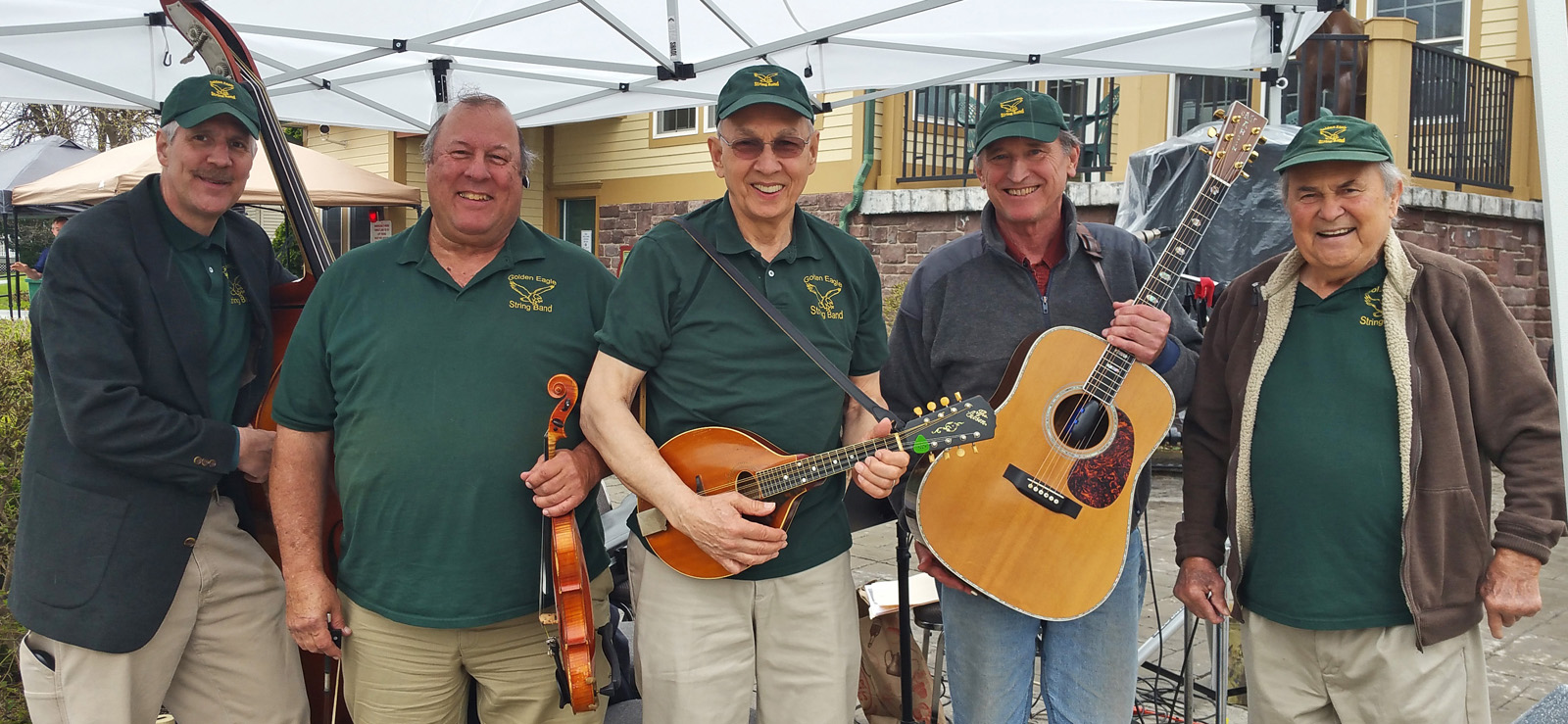 The Golden Eagle String Band is ready to perform at Brockport's Welcome Center, before the Low Bridge High Water Saturday events in May.  (L to r) Ted Sherwood, bass; Dwight Garrow, fiddle; Mike Mumford, mandolin; Eric Carlson, guitar; and, Bill Hullfish, tin whistle. Mike Mumford has been with the band for 38 years, since it began. The newest member is Ted Sherwood who has been with the band 12 years.  Photo by Dianne Hickerson