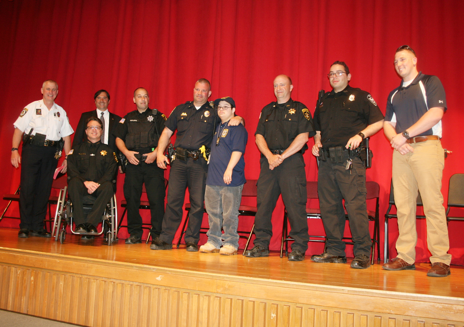 "(L-r) Gates Police Chief James VanBrederode, Gates Town Supervisor Mark Assini, Orleans County Sheriff Randy Bower, Orleans County Deputy James DeFilipps, Gates Police Officer Shawn O'Mara, ""Officer Nick"" Pifer, Orleans County Chief Deputy Michael Mele, Holley Police Officer Miguel Bermudez and Gates Police Officer Ed Bower. Provided photo"