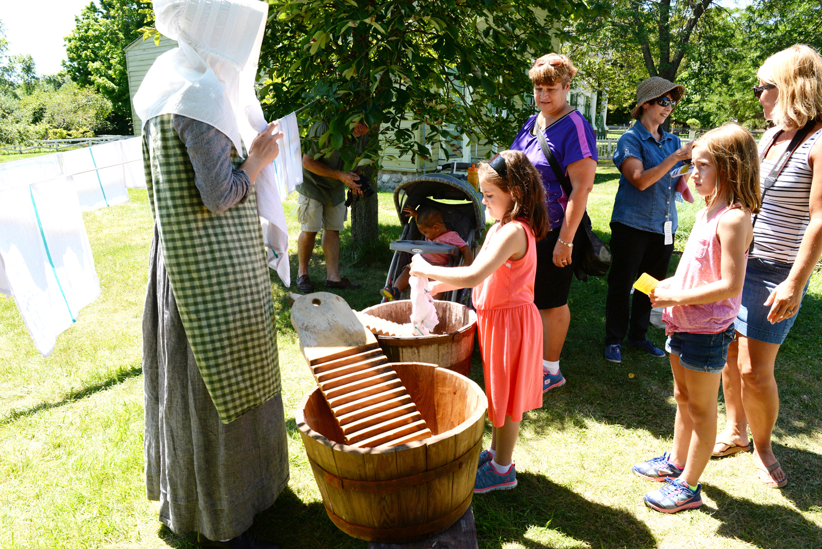 Young fans of Laura Ingalls Wilder experiment with wooden washboards at Genesee Country Village & Museum's Laura Ingalls Wilder Days. Provided photo