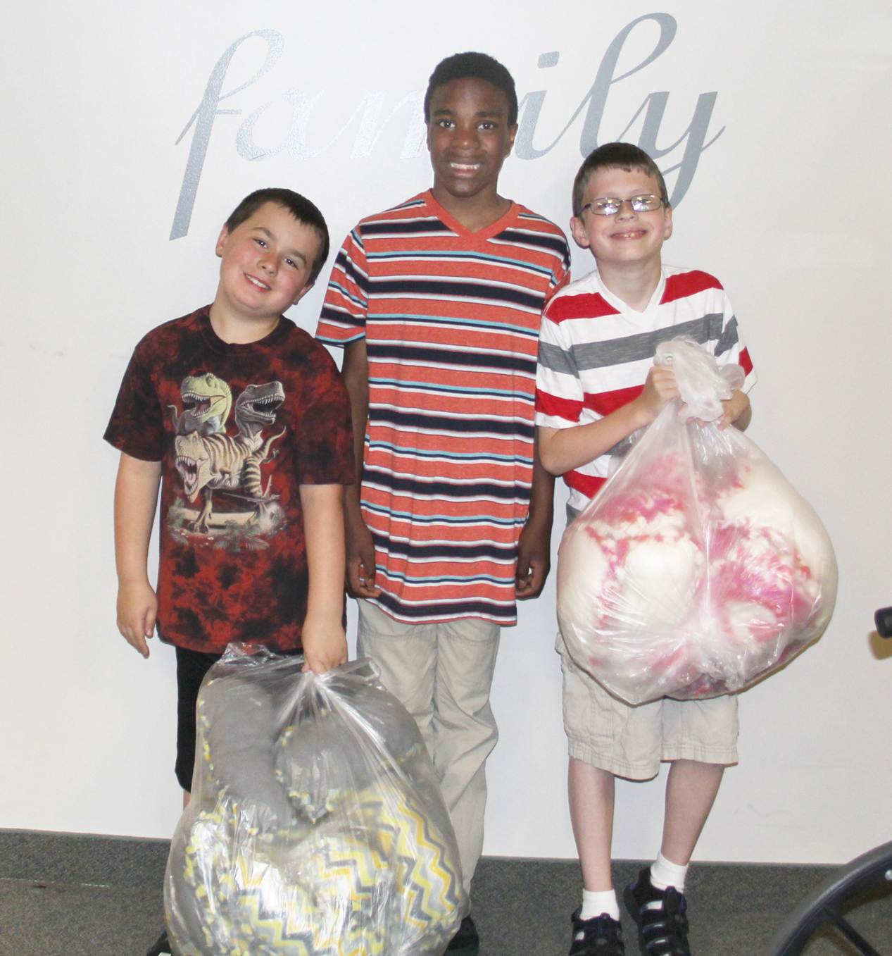 (L-r) Jackson Kieffer, Noah Maxwell and Damien Lupiani hold the collection of neck pillows that their BOCES class made for the residents of Beikirch Care Center. Provided photo.